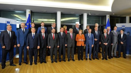 EU heads of state and other officials pose for a group photo during an EU summit in Brussels on Sunday, Oct. 25, 2015. Front row left to right, Bulgarian Prime Minister Boyko Borisov, Albanian Prime Minister Edi Rama, Hungarian Prime Minister Viktor Orban, President of the former Yugoslav Republic of Macedonia Gjorge Ivanov, European Parliament President Martin Schultz, Slovenian Prime Minister Miro Cerar, European Commission President Jean-Claude Juncker, German Chancellor Angela Merkel, European Council President Donald Tusk, Romanian President Klaus Werner Iohannis, Austrian Chancellor Werner Faymann, Executive Director of the European Asylum Support Office Robert Visser, Serbian Prime Minister Aleksandar Vucic and Greek Prime Minister Alexis Tsipras. Back row left to right, Executive Director of Frontex Fabrice Leggeri, Dutch Minister for Migration Klaas Dijkoff, European Commissioner for Migration and Home Affairs Dimitris Avramopoulos, European Union High Representative Federica Mogherini, European Commission Vice-President Frans Timmermans, European Commissioner for Enlargement Johannes Hahn and European Commissioner for Humanitarian Aid Christos Stylianides. (AP Photo/Francois Walschaerts)