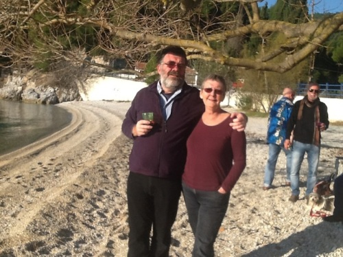 Mark and Caroline on Agnontas beach, Christmas Day, 2014 The two thugs in the background are actually quite harmless