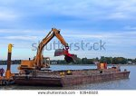 stock-photo-barge-dredging-lake-erie-93940828