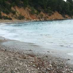 Stafylos beach, people are still swimming there.